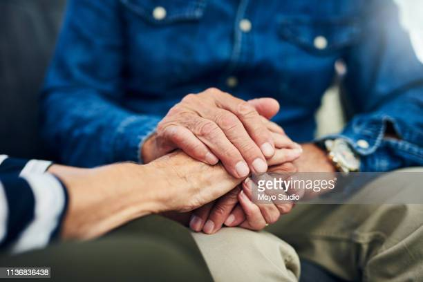 keep love close to home - holding hands stock pictures, royalty-free photos & images