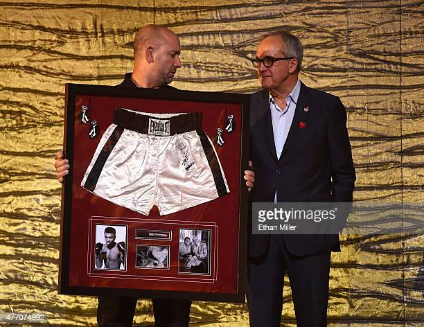 Keep Memory Alive Founder and Chairman Larry Ruvo auctions off Muhammad Ali's boxing trunks from his Thrilla in Manila bout against Joe Frazier...