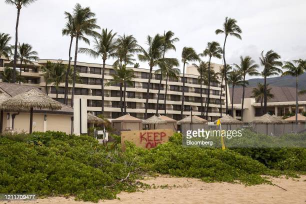 A Keep Out sign is displayed in front of the Sheraton Maui Resort Spa in Lahaina Hawaii US on Friday April 24 2020 Tourism makes up onefifth of...