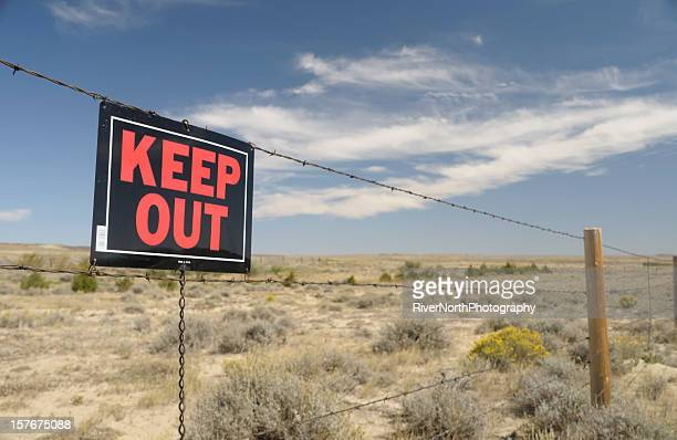 Keep Out sign on a barb wire fence