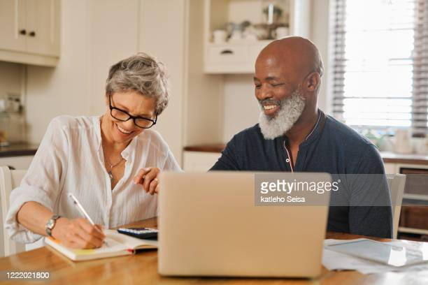 keep saving to ensure you enjoy a long, comfortable retirement - form filling stock pictures, royalty-free photos & images