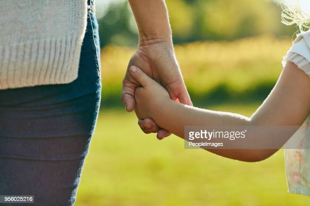 keep them close, keep them safe - childhood stock pictures, royalty-free photos & images
