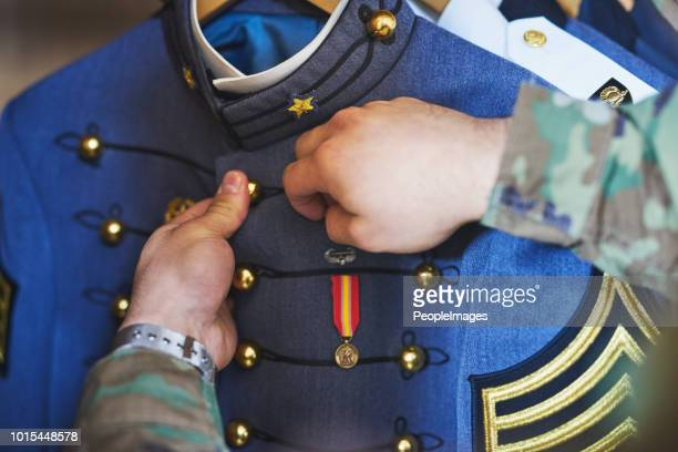 keep your heroism close to your heart - medallion stock photos and pictures