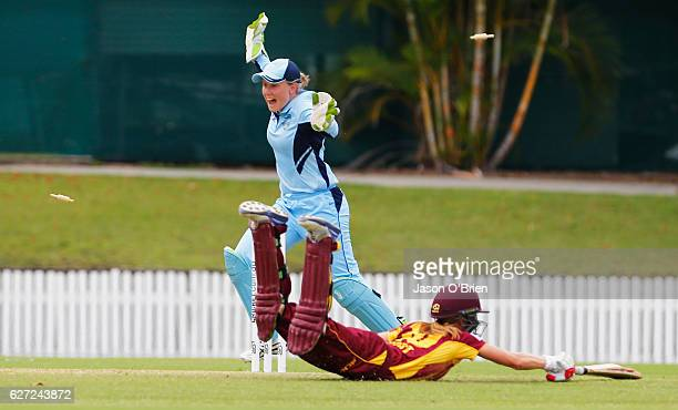 Keeper Alyssa Healy celebrates the runout of Kirby Short during the WNCL Final match betwee Queensland and New South Wales at Allan Border Field on...