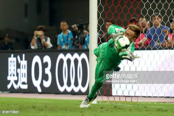 Keeper Christian Fruechtl safes a penalty during the penalty shootout of the Audi Football Summit 2017 match between Bayern Muenchen and Arsenal FC...
