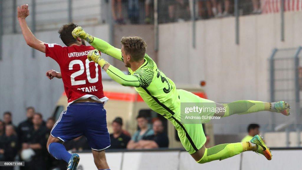 Keeper Daniel Batz of SV Elversberg challenges Dominik Stahl of Unterhaching during the Third League Playoff leg two match between SV Elversberg and SpVgg Unterhaching at Ursapharmarena on May 20, 2017 in Neunkirchen, Germany.