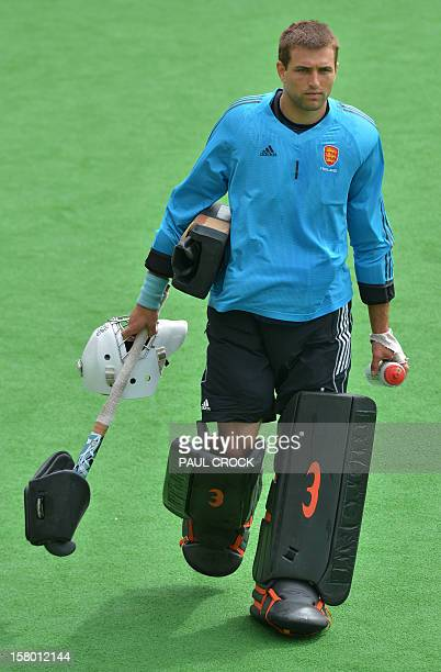 Keeper George Pinner of England leaves the field after New Zealand won their match at the men's Hockey Champions Trophy tournament in Melbourne on...