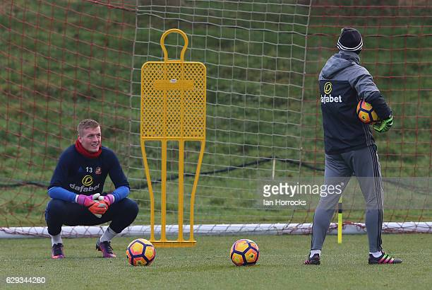 Keeper Jordan Pickford talks to coach Adrian Tucker during a SAFC training session at The Academy of Light on December 12 2016 in Sunderland England
