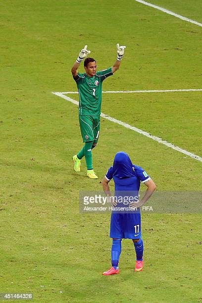 Keeper Keylor Navas of Costa Rica reacts after saving a penalty kick by Theofanis Gekas of Greece during the 2014 FIFA World Cup Brazil Round of 16...