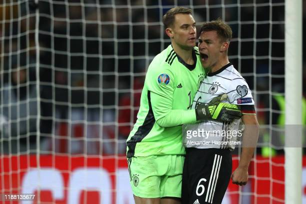 Keeper Manuel Neuer of Germany celebrates with his team mate Joshua Kimmich during the UEFA Euro 2020 Qualifier between Germany and Belarus on...