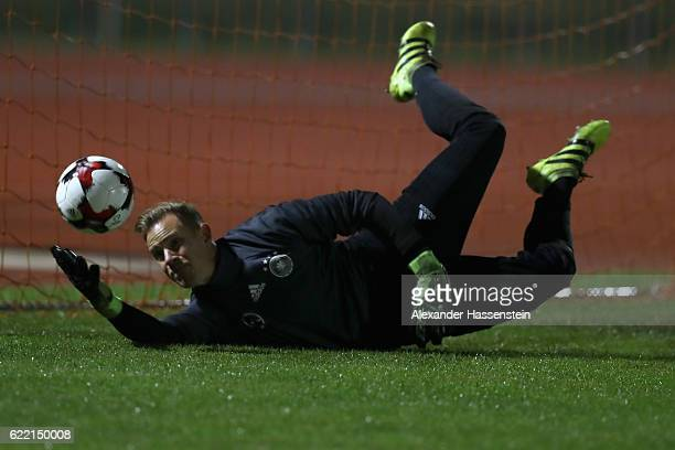 Keeper MarcAndre ter Stegen safes the ball during a training session of the German national team at Stadio di Santamonica di Misano Adriatico on...