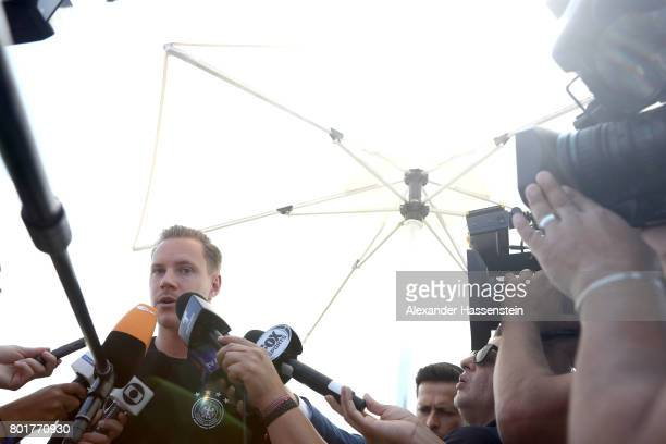 Keeper MarcAndre terStegen of Germany talks to the media during a mixed zone press conference prior to a team Germany training session at Park Arena...