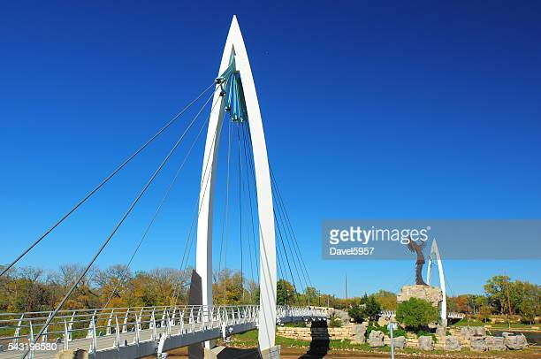 keeper of the plains suspension bridge and statue - wichita stock pictures, royalty-free photos & images
