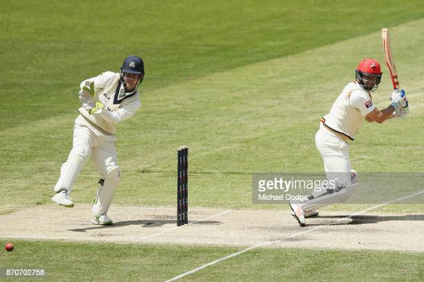 Keeper Sam Harper of Victoria looks on as Callum Ferguson of South Australia bats during day three of the Sheffield Shield match between Victoria and...