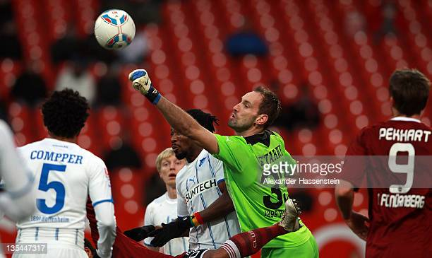 Keeper Tom Starke of Hoffenheim safes the ball during the Bundesliga match between 1FC Nuernberg and TSG 1899 Hoffenheim at Easy Credit Stadium on...