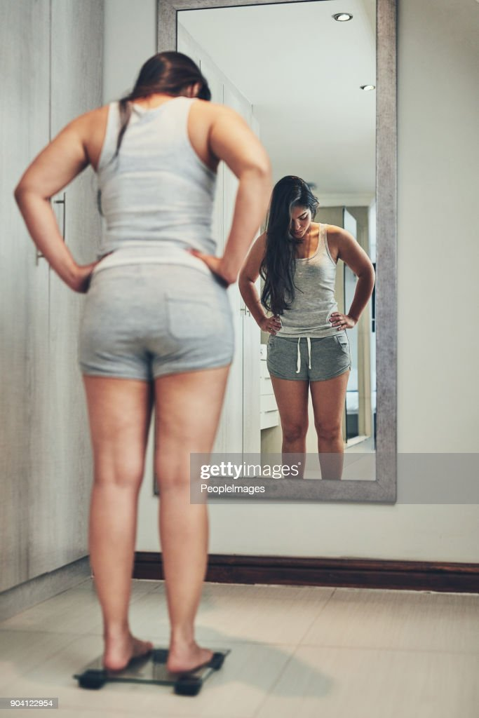 Keeping a close eye on her weight : Stock Photo