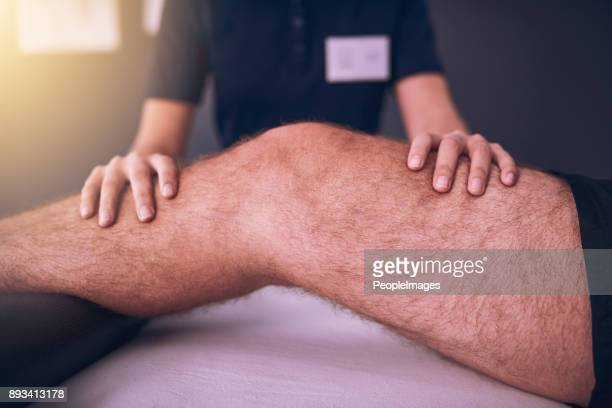 keeping a close eye on his knee - patella stock pictures, royalty-free photos & images