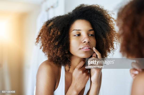 Keeping a close eye on the health of her skin