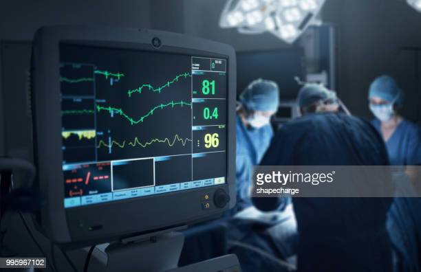 keeping a close monitor on the patient's state of health - pulse trace stock pictures, royalty-free photos & images