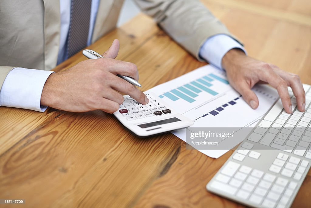 Keeping an eye on the figures : Stock Photo