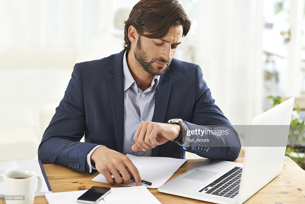 Keeping an eye on the time : Stock Photo
