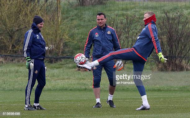 Keeping coach Adria Tucker with Steven Harper and Jordan Pickford play keep ups during a Sunderland training session at the Academy of Light on March...