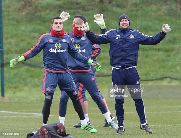 Keeping coach Adrian Tucker warms up the three keepers Vito Mannone Jordan Pickford and Steven Harper during a Sunderland training session at the...