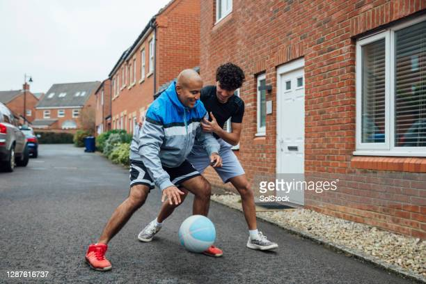 keeping fit with dad - generation z stock pictures, royalty-free photos & images