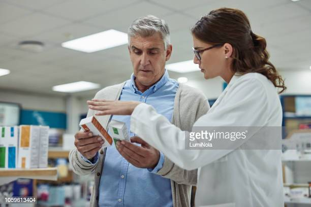 keeping her customers healthy is her passion - pharmacist stock pictures, royalty-free photos & images