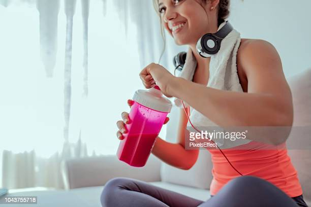 keeping her energy levels up - protein drink stock pictures, royalty-free photos & images