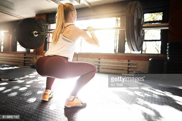 Keeping her glutes tightened and toned