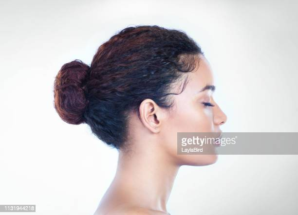 keeping her makeup simple but effective - hair bun stock pictures, royalty-free photos & images