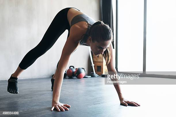 keeping her muscles stretched to avoid injury - legs apart stock pictures, royalty-free photos & images