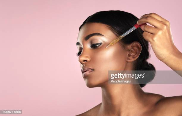 keeping her skin perfect - applying stock pictures, royalty-free photos & images