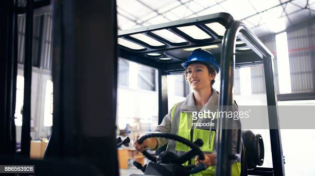 keeping her warehouse well stocked and organized - forklift stock pictures, royalty-free photos & images