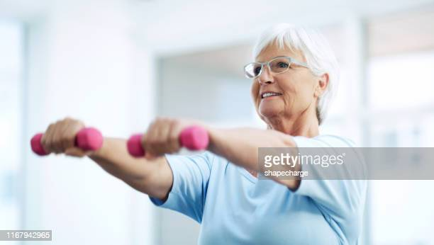 keeping herself fit and healthy in her latter years - arthritis stock pictures, royalty-free photos & images