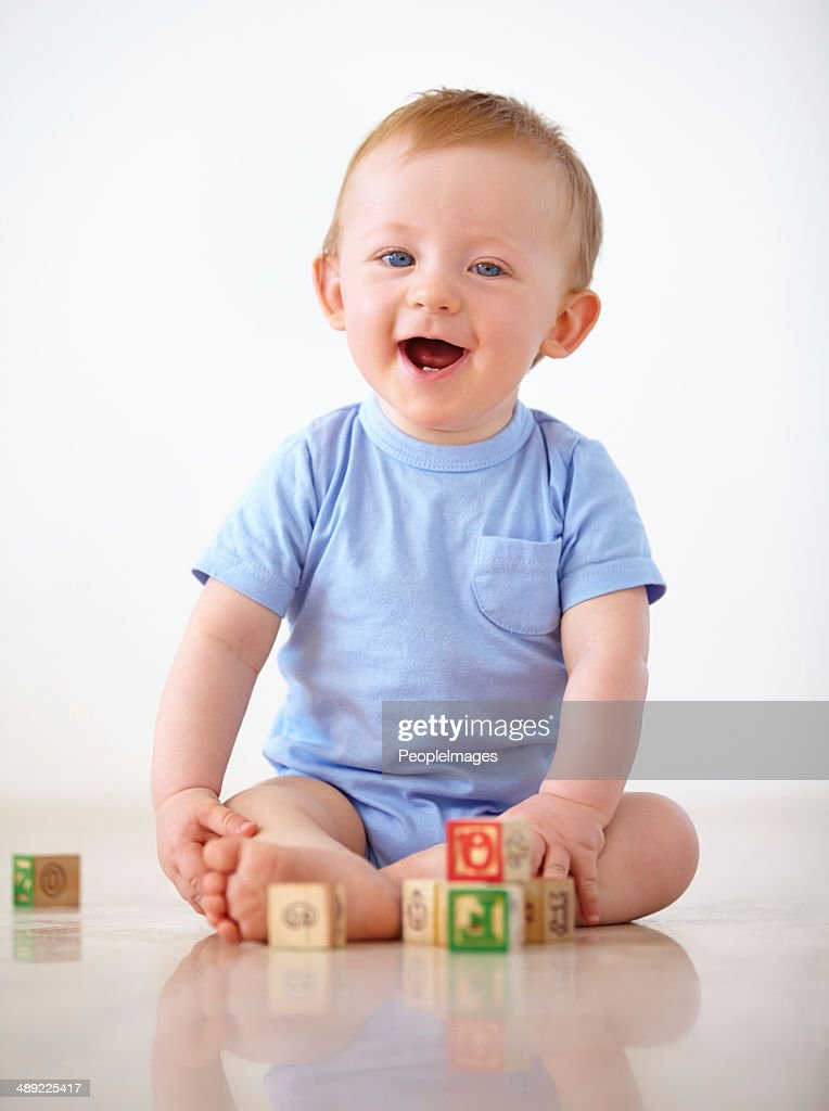 Keeping himself entertained at home : Stock Photo