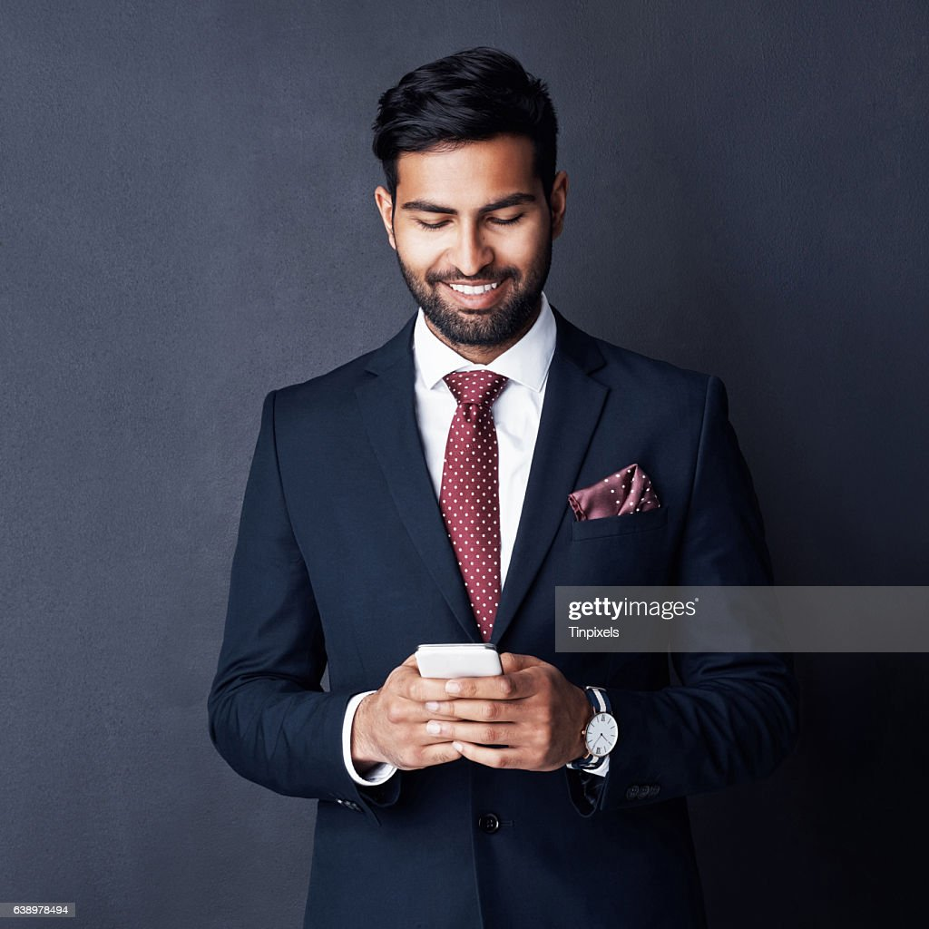 Keeping his career on track by staying connected : Stock Photo