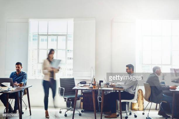 keeping his cool amongst the chaos - white collar worker stock pictures, royalty-free photos & images