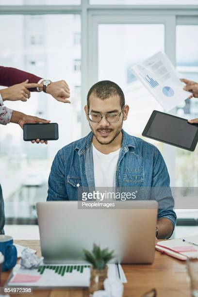 keeping his cool in the eye of the workday storm - delegating stock photos and pictures