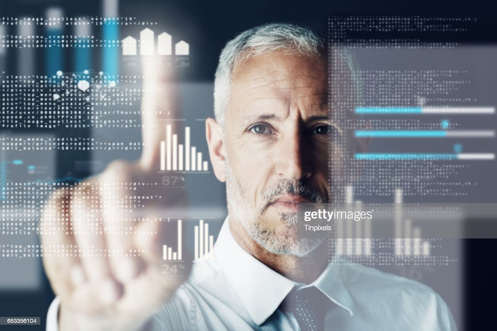 Keeping his finger on the stock market's pulse : Stock Photo
