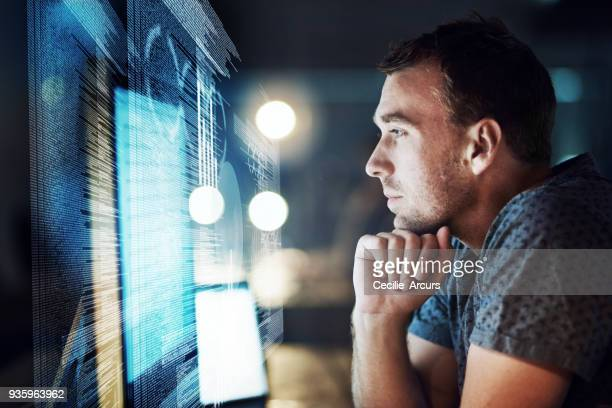 keeping his focus as he cracks the code - brilliant stock photos and pictures