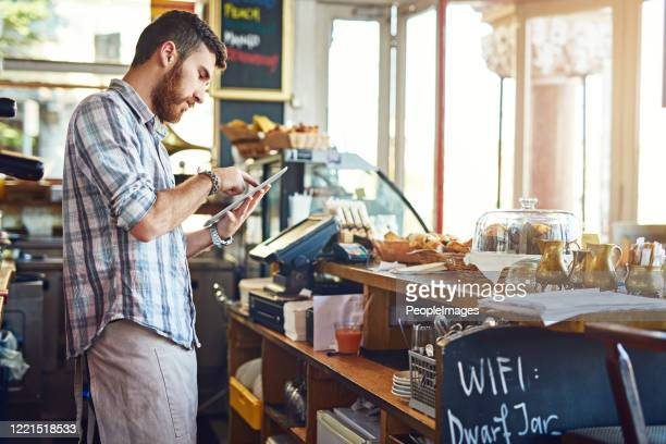 keeping his online menu updated - ireland stock pictures, royalty-free photos & images