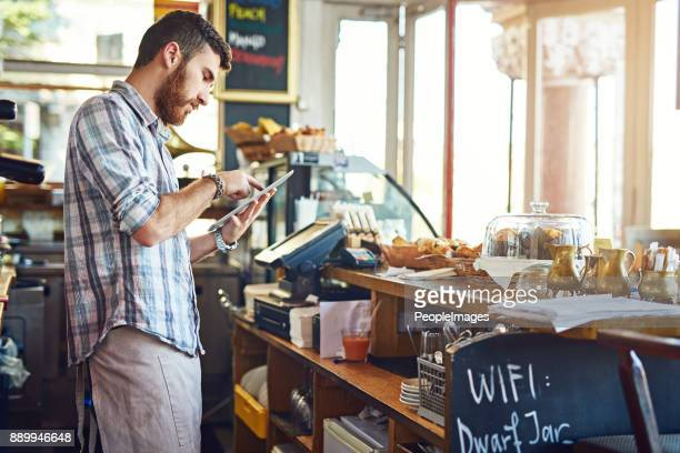 keeping his online menu updated - wait staff stock pictures, royalty-free photos & images