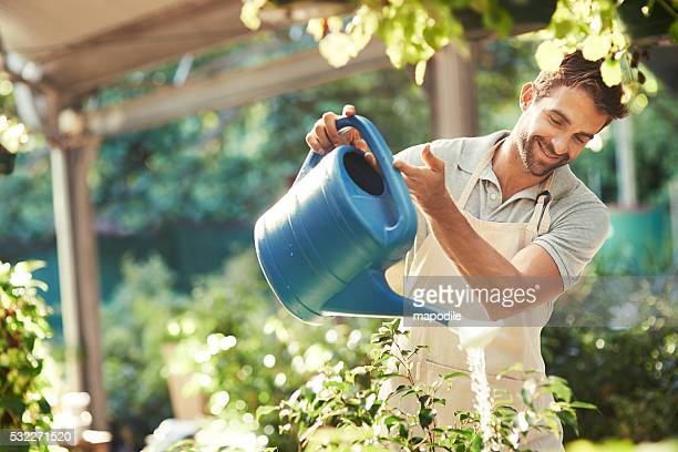 Keeping his plants hydrated and refreshed