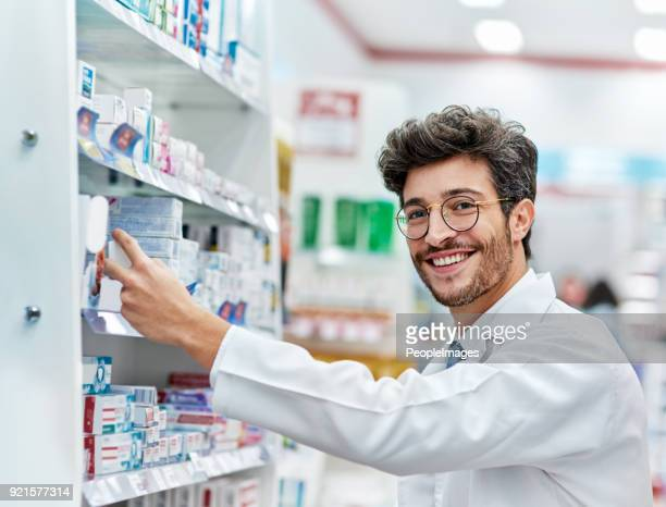 keeping his shelves well-stocked - pharmacy stock pictures, royalty-free photos & images
