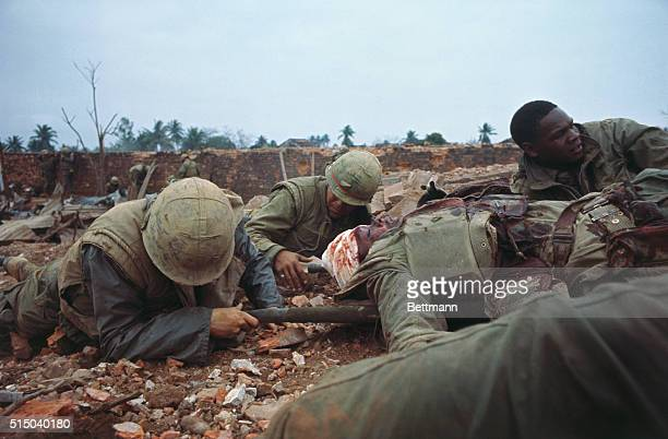 Keeping low to avoid enemy fire US Marines push one of their wounded out of range during fighting in the old section of Hue