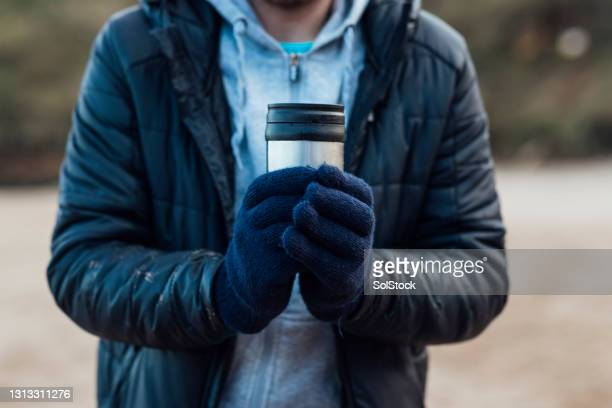 keeping my hands warm - glove stock pictures, royalty-free photos & images