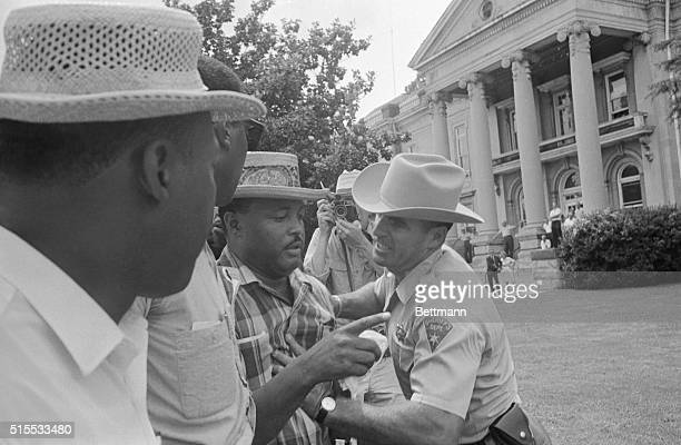 Keeping Negroes off the grass Le Flore Co Deputy Sheriff pushed Hosea Williams on chest as he trys to prevent Mississippi freedom marchers from...
