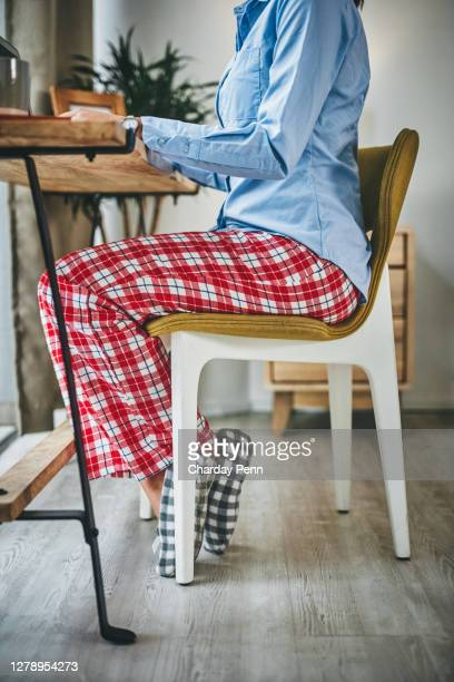 keeping productive and staying cosy - pyjamas stock pictures, royalty-free photos & images